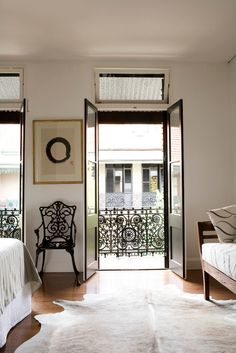 Double doors, animal skin rug and Juliet balcony.