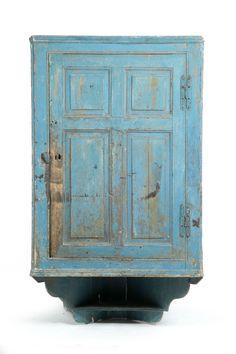 American, 18th century, pine. Raised-panel door, lower shelf, and old blue paint