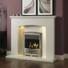 The Gallery Cartmel Marble Fireplace Suite consists of the Cartmel arctic white marble surround with downlights, arctic white marble set and optional Gallery Callisto gas fire. The Cartmel stone surround has a shallow arch with plain legs, White Fireplace Surround, White Fireplace Mantels, Electric Fireplace With Mantel, Fireplace Mantel Surrounds, Build A Fireplace, Home Fireplace, Marble Fireplaces, Fireplace Design, Fireplace Ideas