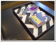 Turn a regular black tray into a decorative one with some fabric, a glue gun, and 5 minutes!