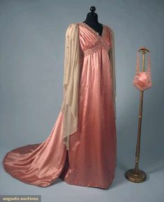 "ROSE PINK EVENING GOWN, 1910 Silk satin Aesthetic style, high waist, beaded & pearl trimmed bands that criss-cross around bustline, trained skirt, long Renaissance style cream chiffon sleeves w/ pearl & beaded edge, matching small shield shaped evening bag, B 36"", Hi W 32"", (small hole in 1 sleeve, chiffon gray w/ age) good"