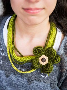 Finger knit flower necklace from Finger Knitting Fun, by Vickie Howell  Photography by @coryryan   Yarn: Bernat Sheep(ish) by Vickie Howell