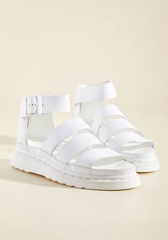 A strut down the sidewalk in these Dr. Martens sandals feels exactly like taking to the stage! This pair's collection of classic leather straps and sleek hardware raises the curtain on your overall look, while their chunky flatforms and bright white hue earn themselves a hearty encore.
