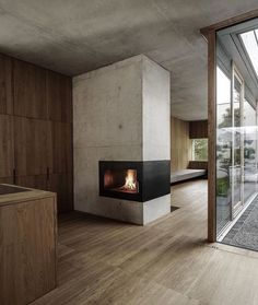 Concrete & Timber House in Austria - the perfect winter fireplace 💭 designed by Marte Marte Architects 📷 by Marc Lins via LUC Design