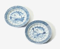 A pair of curved blue and white 'erotic' dishes with outlined rim, Kangxi period (1662-1722)