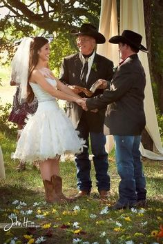 Country / Rustic Chic Wedding: Country bride and groom....short frilly wedding gown with cowboy boots, groom in boots and jeans by pearl808