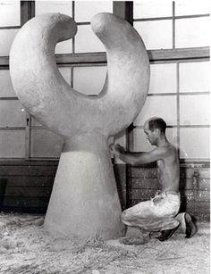 "Isamu Noguchi working on ""MU,"" sculpture for Garden at Shin Banraisha at Keio University, Tokyo, Japan, 1950."