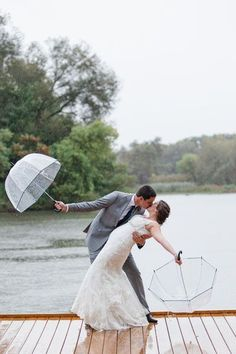 Dealing with just a little drizzle? Hop out from under your umbrellas for a sweet, romantic kiss.