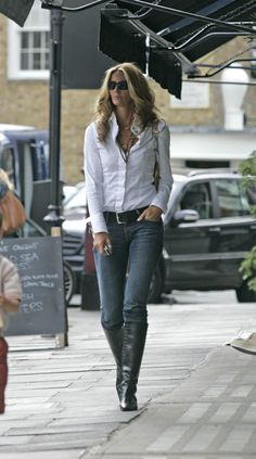 Crisp white shirt with jeans is such a nice look. Nice accessorizing with multiple necklaces and boots