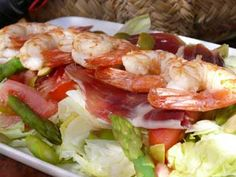 Iberico bellota ham and king prawn salad, the surf and turf of Andalucian summer lunches. More Tapas recipes and suggestions online.