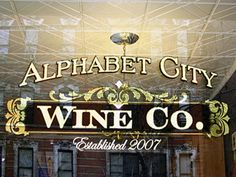 Gold Leaf sign for Alphabet City Wine Company in New York, NY. www.roycesignworks.com created custom gilding sign in New York, we also made their outside carved sign.