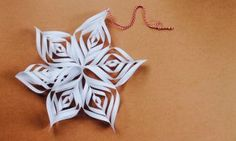 Learn how to make a simple Christmas star decoration! This paper craft is easy for kids and a perfect Christmas activity to enjoy as a family.
