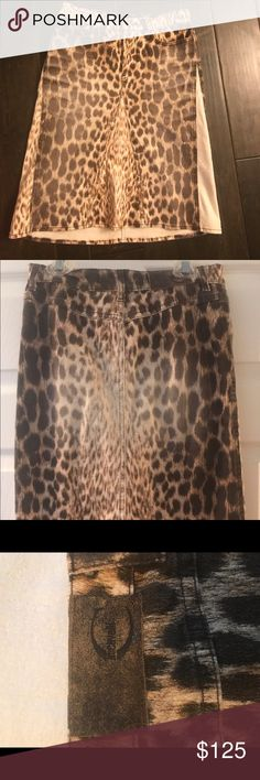 """Authentic Roberto Cavalli animal print skirt Beautiful rare designer piece. Slightly flared A line skirt. Hits to knee or just past depending on height. Skirt length is 20"""" from top of front waistband to bottom of hem. Slightly longer in back with higher back rise as shown. European size 36 would fit a 0-2 a bit of stretch in the denim like material. Any questions please ask. Roberto Cavalli Skirts"""