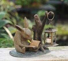 Charleston Gardens - whimsical reading rabbit with lantern, garden ornament