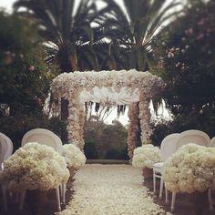 A stunning mock wedding ceremony set in the Rose Garden. #swoon #gethitchedatranchovalencia #karentranflorals