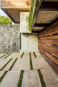 driveway possibly, and look of garage door. Also like the greenery above the door. Really want to achieve this look.