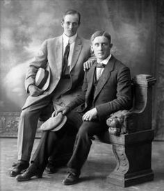 'Group portrait, two men in suits with a hat next. 1912' - digitaltmuseum.no