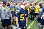 Cancer ended Loszewski's football career following his freshman year of high school, so he wanted to see what he missed out on. His wish: Being a Michigan football recruit for a day.