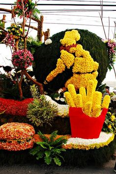 Photo By K3ntb, National French Fries - Baguio Flower Festival 2009 Attracts Thousands of Tourists in Baguio City.  How the people in Baguio City or Province of Benguet celebrate their glorious harvested flowers in season every year while businessess or organizations can market with their float!