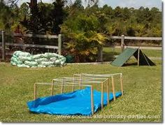 obstacle course idea - wet & slippery - let other kids blast the person going through with water guns