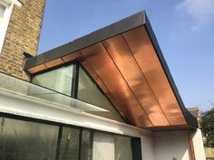 Surrey Zinc Ltd are vastly experienced copper roofing contractors in Surrey. We also specialise in cladding, soffits and facades. Blue Siding, Metal Siding, Metal Roof Houses, House Roof, Black Cladding, Porch Canopy, Zinc Roof, Copper House, Copper Gutters