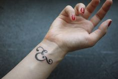 Ampersand wrist tattoo. #tattoo
