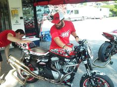 Veterans Empowered Through Motorsports crew member Dallas getting a hand from Shane Narbonne in the M.O.B. Racing pits at Barber Motorsports Park.