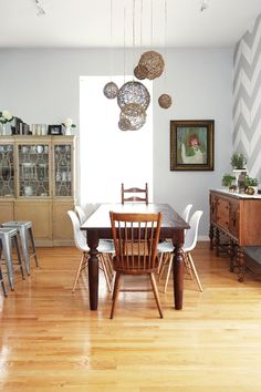 Love the dark wood paired with more contemporary chairs and Tolix stools. Home tour with Shaleah Soliven.
