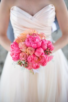 fuschia bouquet by FlorUnique of peonies, pincushion protea, roses and hypericum
