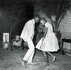 Christmas Eve, 1963 by Malick Sidibé (born 1936) a Malian photographer noted for his black-and-white studies of popular culture in the 1960s in Bamako.