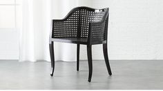 Shop tayabas black cane side chair.   Airy rattan accent slicks up a nouveau take on tradition.  Handwoven of rattan, breezy seat and back keep things light, framed in solid mahogany with a hi-gloss black finish.