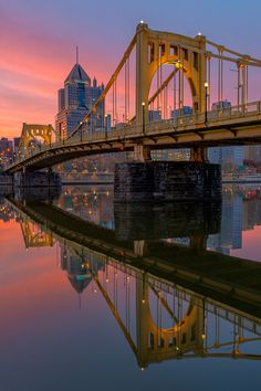 CLEMENTE CROSSING - The Clemente Bridge reflected along the North Shore of Pittsburgh at sunrise. Prints available at www.jpdirollphotography.com © JP Diroll