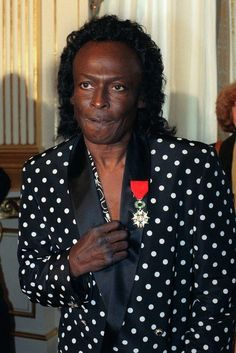 1991 Miles Davis is made a Knight in the French Legion of Honor. Here he is with the medal after the ceremony in Paris on July 16, 1991