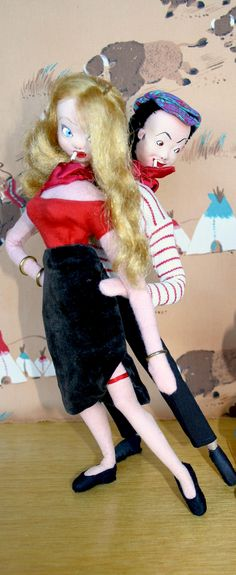 Rare ROLDAN KLUMPE tourist dolls. Pair of French Apache' dancers : the pimp & his working girl. He is in beret & striped top, she is in lowcut top and tight skirt cut with a slit to expose her stockinged leg & garter. In the famous dance, he throws her around, trying to control & dominate her, & she fights back.  Felt clothed dolls. (minkshmink collection)