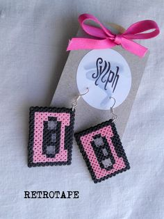 Pixelated pink geeky Retrotape cassette earrings made of Hama Mini Beads made with love for pixel perfect music lovers. These handmade perler beads may differ slightly fr Perler Bead Designs, Hama Beads Design, Pearler Bead Patterns, Diy Perler Beads, Perler Bead Art, Pearler Beads, Fuse Beads, Hama Mini, Perler Earrings
