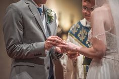 Ring exchange during wedding ceremony at Shrine of The Most Blessed Sacrament in Washington DC.