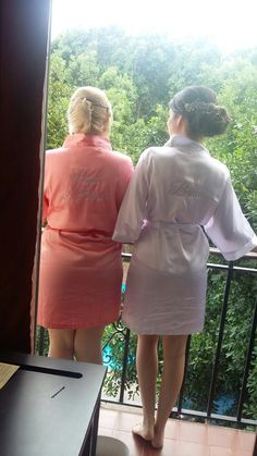 My maid of honor and I while getting ready at the hotel, wearing these cute maid of honor and bride satin robes that I received as a gift