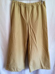 """This is a basic pair of peasant pants. It is a perfect item for a Men's Peasant Renaissance Faire outfit. It is made of 100% cotton. It has an elastic waistband. It is available in sizes XSmall, Small, Medium, and XLarge. The pants are 36"""" in length, but can be custom made to any desired length."""
