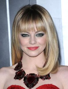 Emma Stone's blunt bangs help give the illusion of length and volume to her fine hair. If you want versatile style without the hassle of maintaining long hair, this cut is perfect. #haircut