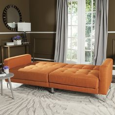 Designed for maximum form and function, this contemporary loveseat instantly transforms into a foldable sofa bed. Its bold orange coloration and clean lines are paired with sleek metal legs, making this a designer favorite for mod city interiors.