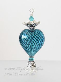 Elegant aqua blue heart shaped perfume bottle is beautiful and unique. I can just see things like this on my dressing table.....lots of pretties