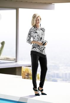 This top takes your look to the next level with bold floral and zebra prints (especially in our wrinkle-free Travelers material).