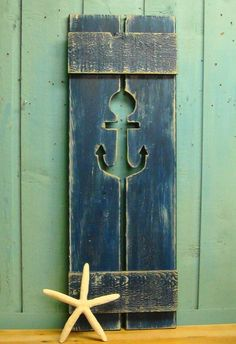 Boat House idea:   Decorative shutter.  Must find!