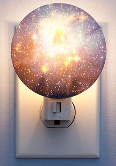 Galaxy You Later Night Light. Youve always favored a cloudless night sky where you can sit on your porch, wrapped up in a blanket, and search for shooting stars and constellations. #multi #modcloth
