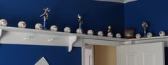 Husband built a shelf all the way around our son's room to hold his baseball collection and trophies.~ My new favorite space saver!~