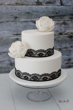 Small white wedding cake with black lace detial and large white flowers. Modern/romantic.