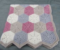 Made to order and ready for dispatch in 5-7 days.  Beautiful baby blanket in pastel shades made from crochet hexagons.  Would make a perfect baby gift.  Blanket measures approx 28inch x 25inch and is made from premium quality acrylic wool.  Made to order please allow 7-10 working days.