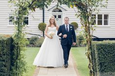 The Bride and her father leave the Old Coach House, for the ceremony at Blake Hall Weddings. london bride photography