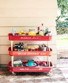 This little red wagon-turned-bar cart couldn't be cuter! Wheel it out at your next outdoor party to instantly add a touch of nostalgic charm to your beverage display.