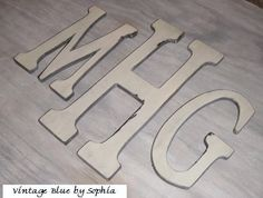 Our married monogram, for our foyer maybe? /// Distressed Wooden Letters Monogram. $76.00, via Etsy.